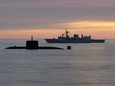 Royal Canadian Navy Halifax class frigate HMCS Montreal & Victoria class attack submarine HMCS Windsor.