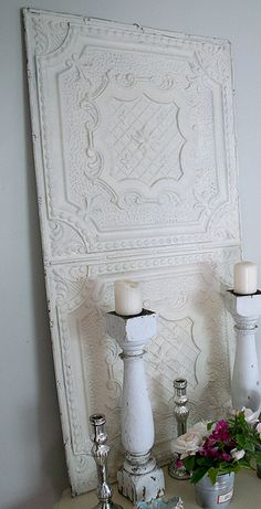 painted tin ceiling tiles, table legs as candle holders