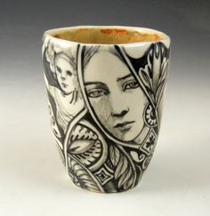 Hand formed, one of a kind porcelain tea cup with black and white illustrations all over and a light gold interior. It is 3.5 tall by 2.75 wide and holds about 6 ounces of your preferred beverage. Each of my cups is a one of a kind and is lead free and food safe