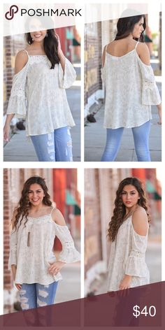 Cold shoulder lace detail tunic Beautiful and lightweight, perfect for summer!   This cold shoulder lace detail tunic with bell sleeves is a very light cream color with a delicate floral pattern throughout.  Adjustable spaghetti straps make it a perfect fit for all!   Gorgeous! Infinity Raine Tops Tunics