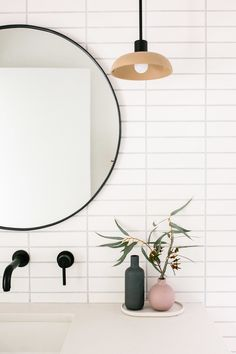 Mid-Century Modern Bathroom Renovation: White Oak Custom Bathroom Vanity Cabinet with Matte Black Hardware and Wall Mounted Faucet. Round Mirror with Ceramic Pendants and Terrazzo Tile Floors. 2X8 White Stacked Subway Tile (Vertical)
