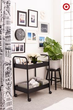 A black-and-white color palette will turn a basic bathroom into your dream bathroom. Use a black bar cart as a modern take on organization, hang our cityscape shower curtain for an urban feel, and create a gallery wall as an added touch of personality.