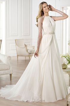 "Winterize a classic Grecian dress by adding heavily embellished illusion sleeves. Gown by Pronovias (Style ""Yajaida"")."