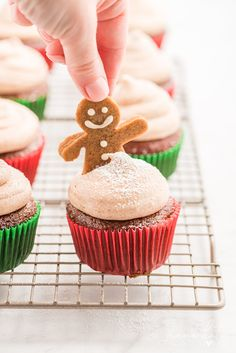 This gingerbread cupcake recipe is a delicious addition to any holiday dessert table! These moist cupcakes, topped with cinnamon cream cheese frosting, will be a new holiday favorite. Favorite Holiday, Holiday Fun, Cupcake Recipes, Dessert Recipes, Moist Cupcakes, Gingerbread Cupcakes, Top With Cinnamon, Cinnamon Cream Cheese Frosting, Party Desserts