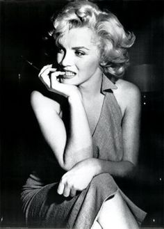 Marilyn Monroe...This is my all time most favorite picture, ever. I have a big poster of this pic in my room.