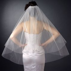 """The double layer fingertip length veil has a cut edge design with Swarovski crystal scattered throughtout the veil. Available in white or ivory. Size: 30"""" x 36"""" x 72"""". $54.99. #kimsbridal #veils"""