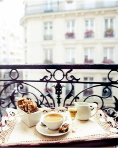 Breakfast in Paris. Trés jolie! I'm willing to get out of bed to sit on this little balcony. <3