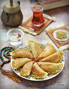 Qatayef,Atayef Middle eastern pancakes,There is Something wonderful about dishes that are only served in special occasions, and one of those are Atayef or Qatayef :) when we say Ramadan, then it's Qatayef! as they are Ramadan stable dessert. Middle East Food, Middle Eastern Desserts, Ramadan Desserts, Ramadan Recipes, Ramadan Food, Brunch Recipes, Sweet Recipes, Dessert Recipes, Atayef Recipe Cheese