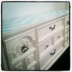 I bought this old dresser.  It was ugly, old, brown, heavy, and missing a few pieces, but had a little character to it. I sanded it and painted it and this is how it turned out!  Love it!