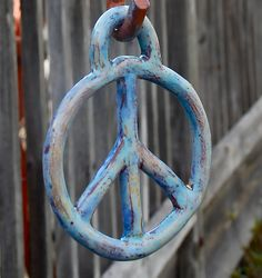 Hanging Ceramic Peace Sign by WelcomeHouseStudio on Etsy, $35.00
