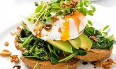 Rye Toast with Poached Free-Range Eggs, Wilted Spinach, Avocado and Sprouts