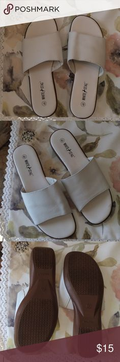 ✨White Stag White Leather Sandals✨ 8 1/2✨✨ Just in time for summer these like new comfortable slip on sandals will be your go to all season long! Super flexible soles with traction will let you walk and be comfortable all day! In excellent condition too. Heels are a little less than 1 1/2 in. White Stag Shoes Sandals