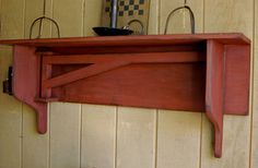 I pinned DIY instructions for a swing arm quilt hanger, now I can get my hubby to make a shelf to go with it.
