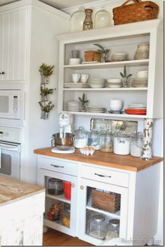 Farmhouse hutch baking station with Christmas red and fresh greenery