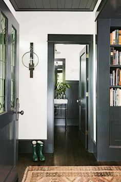 Black Interior Doors - Dramatic Or Conventional? When you need a truly dramatic, dramatic look, nothing is more dramatic than the use of black interior doors. Black doors give you the kind of feel that . Dark Grey Walls, Dark Wood Floors, White Walls, White Wood, Grey Wood, Dark Doors, Grey Front Doors, Front Entry, Entry Doors