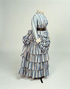 1884-1886 Tennis costume, bodice and skirt of cotton, woven with narrow stripes of light blue, dark blue and pink. Bodice has watch pocket.