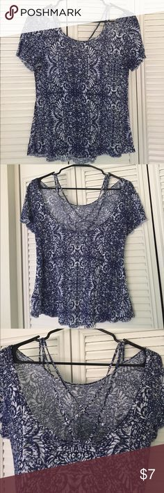 Blue and white strappy back top. Aeropostale Navy blue, white and small amount of cream shirt from Aeropostale. Super soft material. The back has a slight scoop with straps that cross each other. Aeropostale Tops
