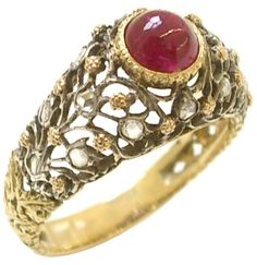 This ring was made by Buccellati in 1960. The ring itself is made of both 18 karat gold and silver, finely wrought to resemble a winding, diamond-set vine with gold flowers. The vine is studded with 14 rose-cut diamonds and surrounds a 2 carat cabochon ruby.  This ring is for sale at Kimberly Klosterman Jewelry, listing available via 1stdibs.