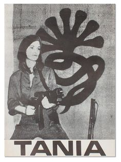 """Patty Hearst, aka """"Tania,"""" immortalized forever before a backdrop of the Symbionese Liberation Army's 7-headed snake. A rare photo-offset poster, ca. 1975."""