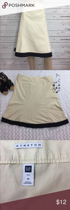 "Tan cotton skirt from The Gap, A-line, size 16 Cute cotton gap stretch skirt with black trim. Great condition. Perfect for summer! Dress up or dress down!!! Measurements: 38"" waist, 25"" length, 46"" hips. GAP Skirts Midi"