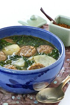 Caldo Verde or Portuguese Green Soup with sausages, potatoes, and kale in an onion and garlic infused broth. It is a hearty and very flavorful soup. #greensoup #heartysoup #comfortfood
