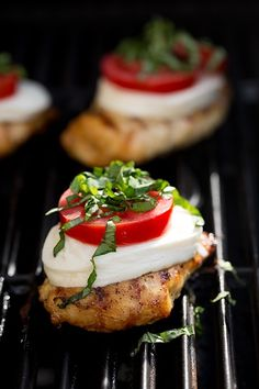 Caprese Grilled Chicken with Balsamic Reduction ♦ balsamic vinegar, boneless skinless chicken breast halves, olive oil, finely minced garlic, sliced fresh mozzarella, sliced Roma tomatoes, chopped basil, salt and freshly ground black pepepr