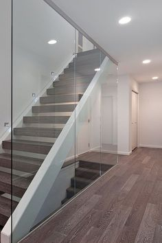Replace old-fashioned banisters with modern panels of glass! BR x Modern Staircase banisters Glass modern oldfashioned Panels Replace Glass Stairs Design, Railing Design, Staircase Design, Stairs With Glass, Modern Stair Railing, Modern Stairs, Stair Treads, Stair Case Railing Ideas, Modern Basement