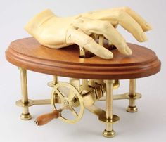 Watch the automaton hand work! I adore how it sounds http://www.youtube.com/watch?v=VDwJ4K3g6Zs  http://www.etsy.com/listing/56571790/hand-operated-automaton-sculpture