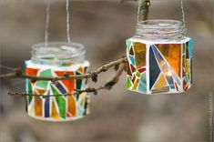 Hanging candle holders from old glass jar and broken colored glass