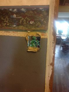 First, remove the  electrical and old trim. The view of the gutted dining room through the opening.