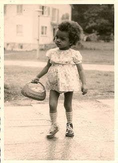 1940's photo .Little African American girl holding basket