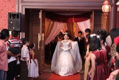 Here comes the beautiful bride, walking to the wedding gate to meet the groom and have a romantic first dance