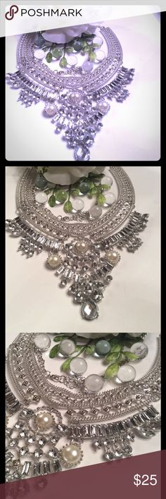"BIB RHINESTONE AND PEARL NECKLACE FASHION ( FAUX ) JEWELRY RHINESTONE AND PEARL SILVER BIB NECKLACE. GORGEOUS! LENGHT IS 18""-24"" DEPENDING HOW TIGHT YOU MAKE IT. LOOKS AWESOME ON A HIGH COLLARED BLACK TOP. NEW IN BAG. FIT FOR A QUEEN👑👑👑 boutique Jewelry Necklaces"