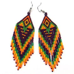 Long Native American Style Seed Bead Earrings in dark ruby, yellow, green and orange tones.