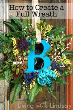 Just a plain ole grapevine wreath.... I like hanging the ribbon through the letter... very cute !