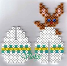 A cute easter bunny hanger pearl template. It is perfect for crafting . Hama Beads Design, Diy Perler Beads, Perler Bead Art, Pearler Beads, Melty Bead Patterns, Pearler Bead Patterns, Perler Patterns, Beading Patterns, Pixel Beads