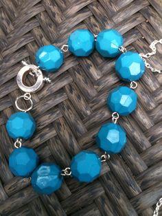 blue faceted bracelet  http://www.etsy.com/shop/TheLittleOwlDen