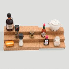 """Made of durable, eco-conscious materials, our Bamboo and Cork 3-Tier Expandable Shelf is a top-notch choice for any kitchen. Stock this attractive storage shelf with spice jars, cookbooks and other kitchen essentials to keep your space organized in style. What You Need To Know Made of bamboo and cork Expandable Product Specifications 12""""W x 8""""D x 4.25""""H $29.99"""