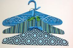 Tutorial: Fabric covered coat hangers - When you're hanging up a special garment, a regular metal coat hanger just won't do. These fabric covered coat hangers are so much nicer! If you're really ambitious, you could m… Fabric Crafts, Sewing Crafts, Sewing Projects, Fabric Covered Hangers, Metal Coat Hangers, Padded Coat Hangers, Wire Hangers, Plastic Clothes Hangers, Hanger Crafts