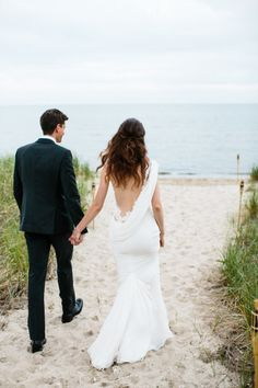 Love the invisible back of this wedding dress: http://www.stylemepretty.com/massachusetts-weddings/cape-cod/2014/11/07/modern-chic-cape-cod-wedding/ | Photography: Joyelle West - http://www.jwestwedding.com/