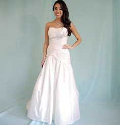 All dresses $300 or Less. Near Asheville NC.  Call us today to book an appointment   828-670-1871