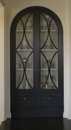 black cabinet with glass panels