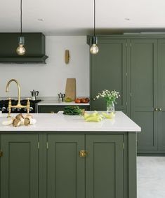 """deVOL Kitchens on Instagram: """"A classic deep olive green paint colour, sleek pale Silestone worktops and an amazing polished concrete floor - this Shaker kitchen…"""""""