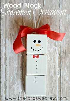 Wood Block Snowman Ornament - let a child paint different faces and bow ties on each side