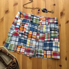 J. Crew Plaid Skirt Adorable patchwork plaid J. Crew skirt with button front. 2 button front side pockets, belt loops, 100% soft cotton, in great condition! 14 inches long with a 28 inch waist. Says it is a size 2! Perfect for a preppy summer outfit! No trades, make an offer! J. Crew Skirts Mini
