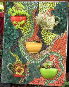 This mosaic is done on Hardibacker cement board. Cups and bowls cut in half and attached with silicone. Mosaic Planters, Mosaic Garden Art, Mosaic Vase, Mosaic Flower Pots, Mosaic Wall Art, Mosaic Tiles, Mosaic Mirrors, Mosaic Crafts, Mosaic Projects