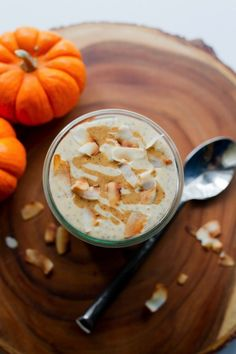 Coconut Pumpkin Chia Pudding // Pumpkin, coconut milk and chia seeds are combined and topped with toasted coconut flakes and an almond butter drizzle to make a thick and creamy chia pudding that's paleo-friendly, vegan and great for breakfast or as a snack.