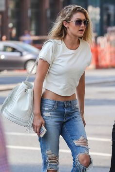 gigi. ripped jeans. bucket bag.