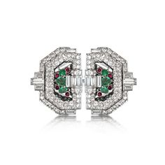 An Art Deco Diamond, Emerald, and Ruby Double Clip Brooch. Available at www.revivaljewels.com