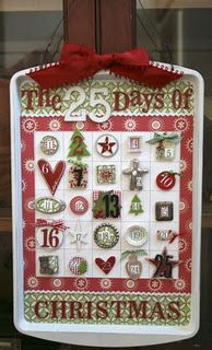 Aluminum pan sprayed white with decopauged scrapbook paper...wire hanger with bow....TOTALLY MAKING THIS!